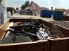 Na obrázku kontejner plný odpadu.